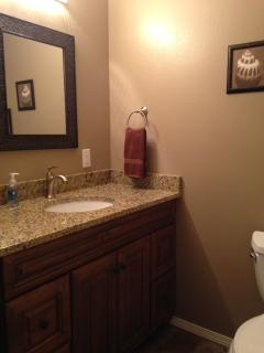 Full master bathroom with tub/shower and granite countertop