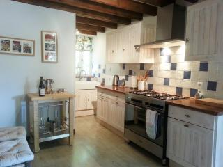 Spacious kitchen with range cooker and space for people to chat to the chef! Updated for this season