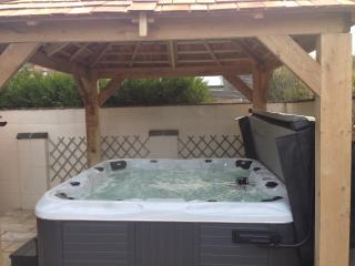 Our new 7 seat hot tub, under a gazebo for all weather use.