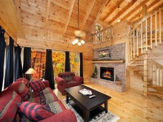 Living Room with Fireplace at Settlin' Inn