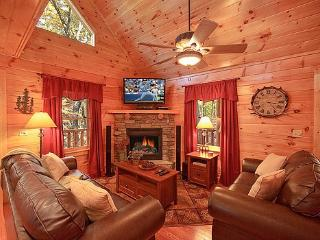 Living Room with Fireplace at Tucked Away