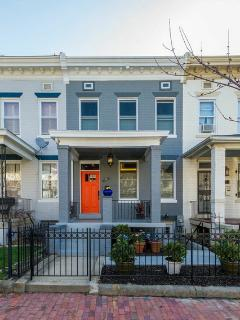 1910 row house sits among others from its era. Renovated in 2015.