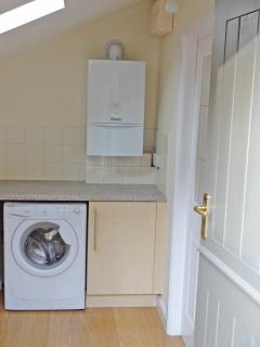 Modern combi boiler means unlimited hot water and washing machine also in the utility entrance
