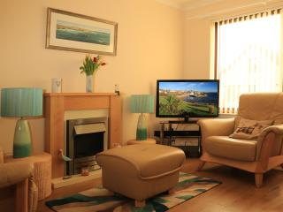 Relax in the comfort of our lovely sitting room