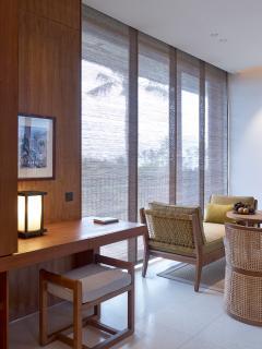 Arnalaya Beach House - Writing desk and living space sofa