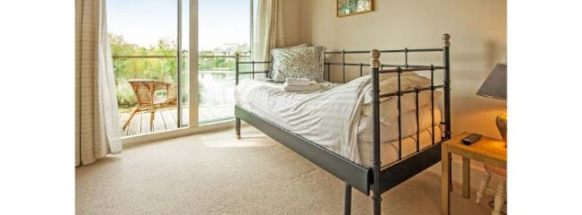 Bedroom 4 with balcony overlooking the lake - bed can be either a single or a double