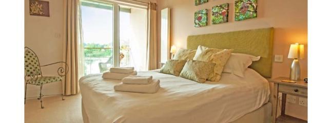 Bedroom 1 with balcony overlooking the lake