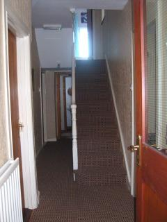 View inside of front door. First bathroom at top of stairs