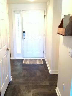 Entryway with closet to washer and dryer. Also a guestbook to provide you with any information you m