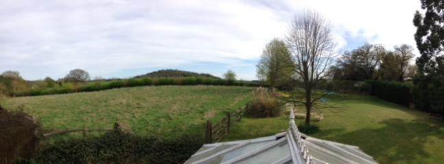 The view from the bathroom window of the gardens and surrounding countryside