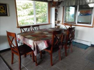 Dining for six shown, but two more chairs available