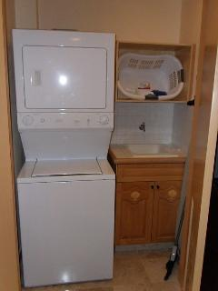 Washer and dryer is next to kitchen