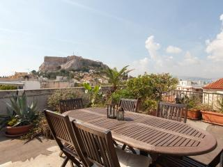 Dining in the roof top terrace wih Acropolis views