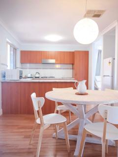Open plan dining area with fully equipped kitchen.