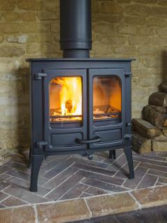 Log burning stove keeps the cottage warm, cosy and romantic during the winter months.