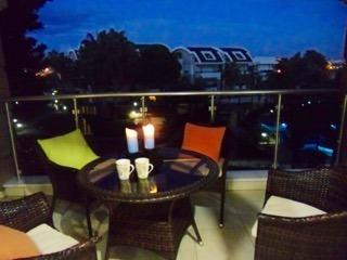Dining on the main balcony overlooking the pool