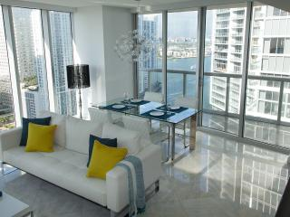 Water views from floor to ceiling windows: Miami River and Biscayne Bay