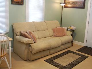 Livingroom has queensize Lazyboy sleeper sofa and new 40' hd tv.