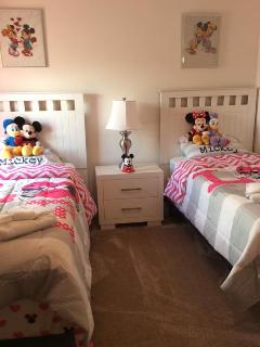 Mickey and Minnie single bads. Shared Bath and shower with Transformer Room.