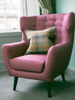 Contemporary furnishings alongside traditional colours and fabrics