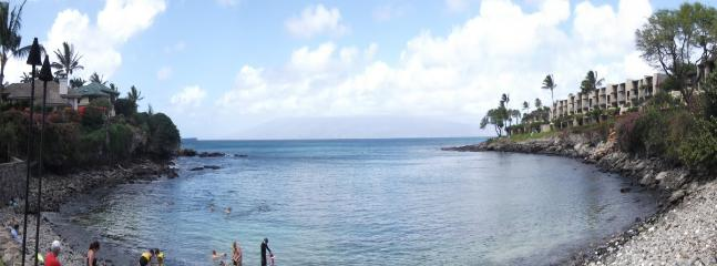 Snorkelers enter the Cove to visit fish, coral & turtles