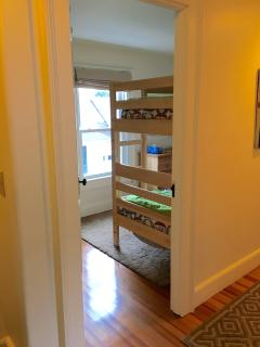 Bedroom with bunk beds is compact, but has window