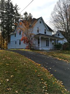 View of house from bottom of driveway in fall