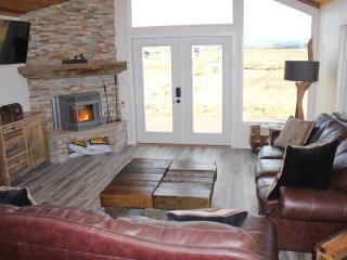 Living room with flat screen TV and automatic pellet stove