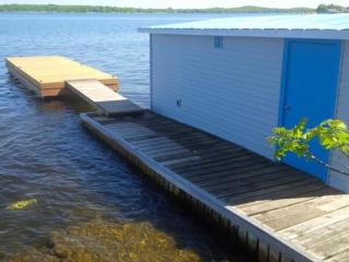 DOCK, BOATHOUSE AND PLENTY OF SWIMMING AREA