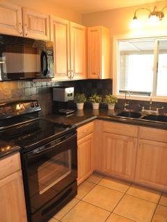 Microwave, range/oven, dishwasher, fridge, deep sink plus cookware!