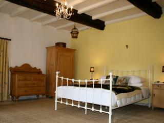 The huge master bedroom has a king size bed plus beautiful soft furnishings