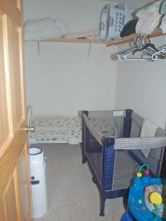 Master bedroom closet, pack and play and toddler bed