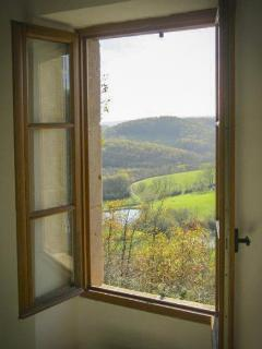 three windows look out over the valley beyond, and one window overlooks the front entrance & garden.