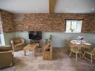 Open plan living area. Note the hand made brick!
