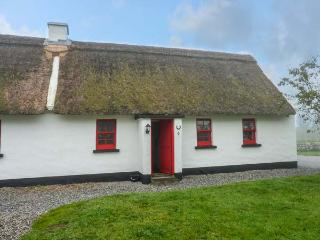 NO. 9 TIPPERARY THATCHED COTTAGES, semi-detached, open fire, character features,