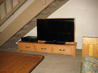 Flat Screen TV and Stairs to Loft