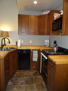 KITCHEN: Double Stainless Steel Sink, Dishwasher, Butcher Block Counters, Microwave, Stove & Oven