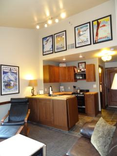 LIVING ROOM: Leather Chair+Ottoman, Convertible Coffee/End Table, Storage Cabinets, Vintage Posters