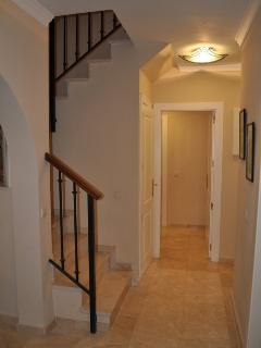 The hallway and stairs to the upper floor of the penthouse.
