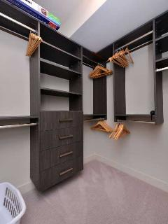 Very large and well equipped walk in closet in the Master Bedroo