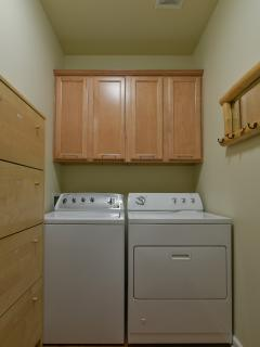 Utility room with washer and dryer.