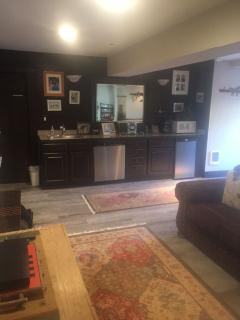 Wet bar on first floor with refrigerator, dishwasher, microwave, etc.