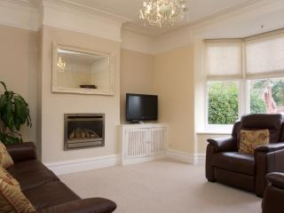 Sitting room with Sky TV and electric reclining sofa and chairs