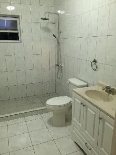 Master Bath With Rain Shower and hand held, 'Comfort height' toilets Hot Water throughout house