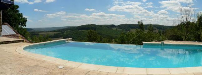 Panoramic view of the poolside area. Note: the fence has been installed since this photo was taken.