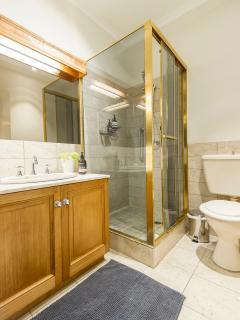 Two proper bathrooms, one with shower, and the other with bath.