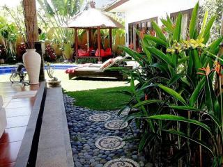 garden with sun beds - sun beans  - swimming pool  - outdoor shower