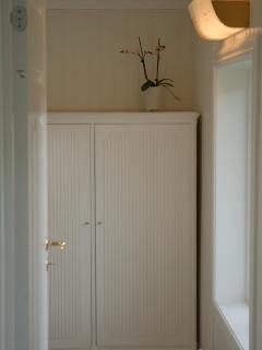 Cabinet for clothing in hallway