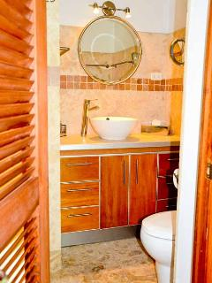 Both bathrooms are identical with vanities with storage and waterfall showers