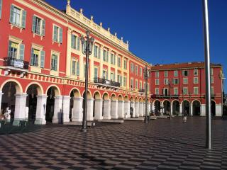 The apartment building with the famous arcads, right on place Massena